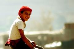 abeer_maadawy_boy_in_red_hat__2007_photograph_cm__50_x_50_egitto