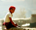 abeer_maadawy_boy_in_red_hat__2007_photograph_cm__50_x_50_egitto